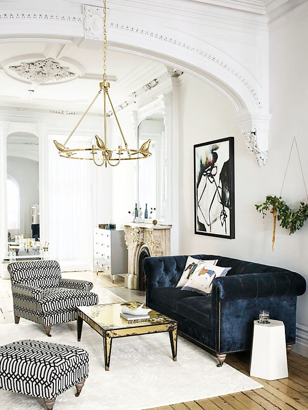Living room with tufted blue velvet chesterfield sofa on Thou Swell @thouswellblog