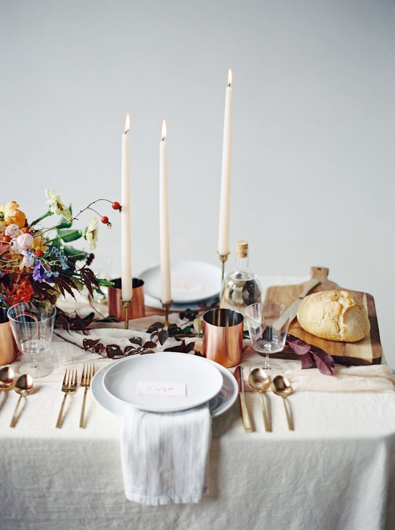 Moody table setting with tall candlesticks and linen tablecloth on Thou Swell @thouswellblog