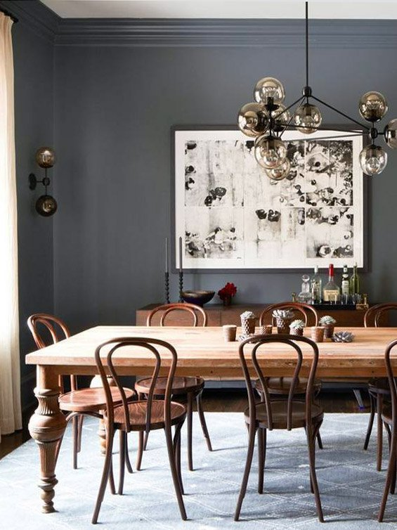 Charcoal grey dining room with antique table and bentwood chairs on Thou Swell #diningroom #diningroomdesign #interiordesign #greywalls #greyroom #greypaint #grey #homedecor