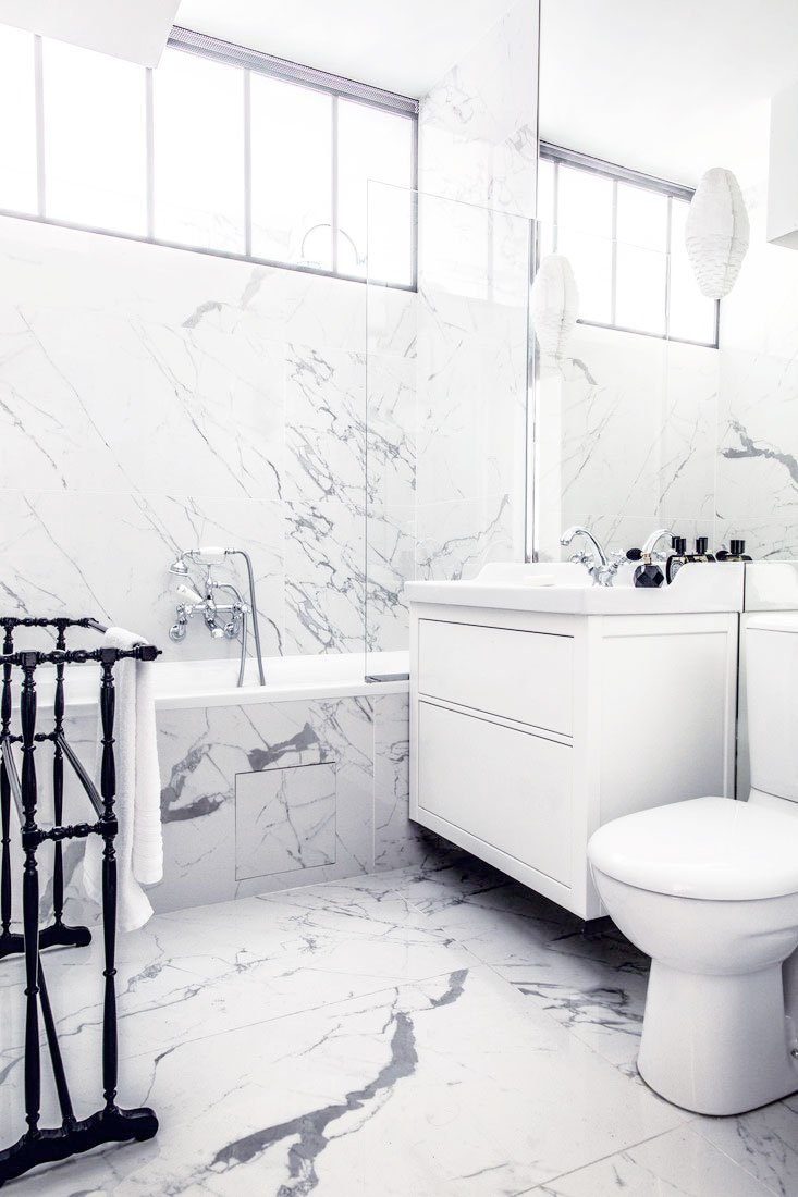 Modern white and marble bathroom in Paris on Thou Swell @thouswellblog