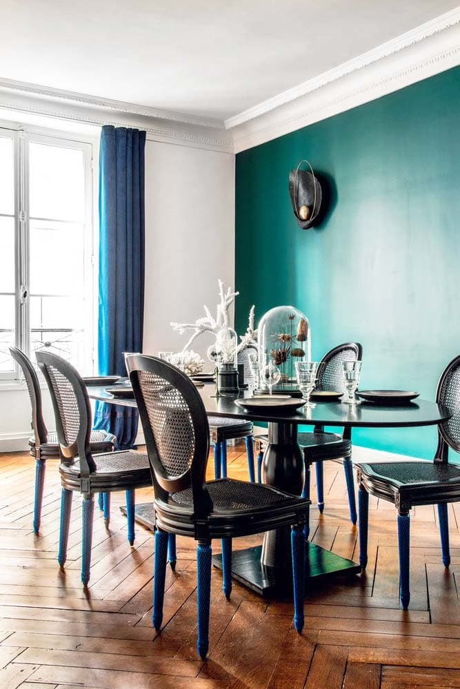 Simple traditional dining room in Paris with teal accent wall on Thou Swell @thouswellblog