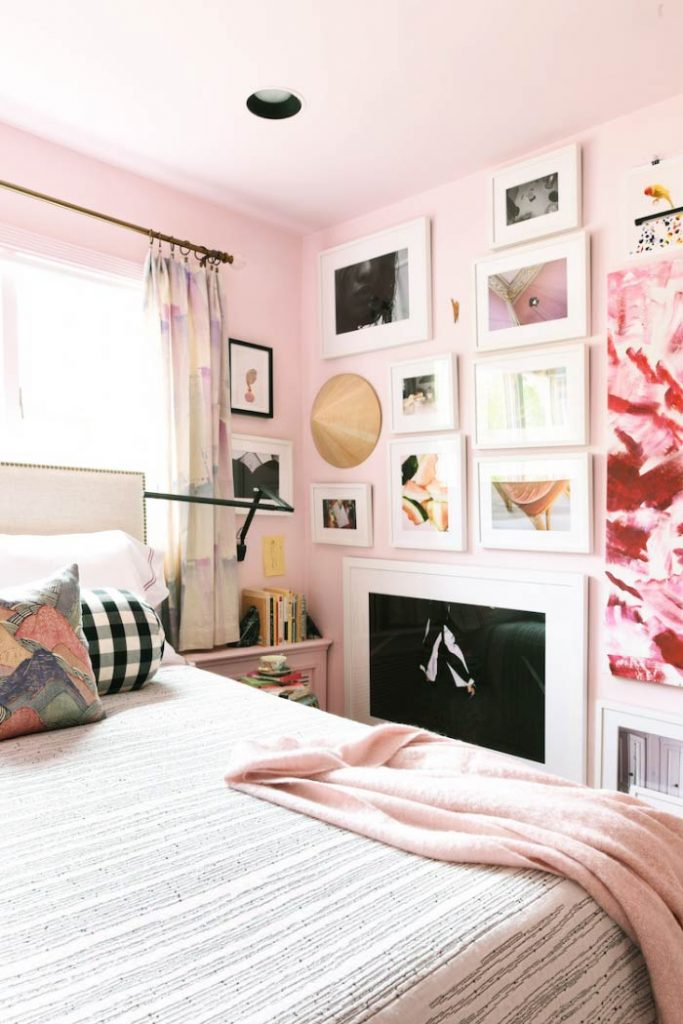 Pink bedroom with wall full of modern art on Thou Swell @thouswellblog #pinkroom #pink #pinkbedroom #bedroom #bedroomdesign #homedecor #homedecorideas #bedroomideas #pinkwalls