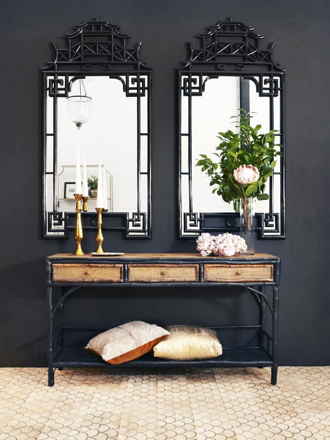 Black walls and bamboo mirrors with lasered cowhide rug from ArtHide on Thou Swell @thouswellblog