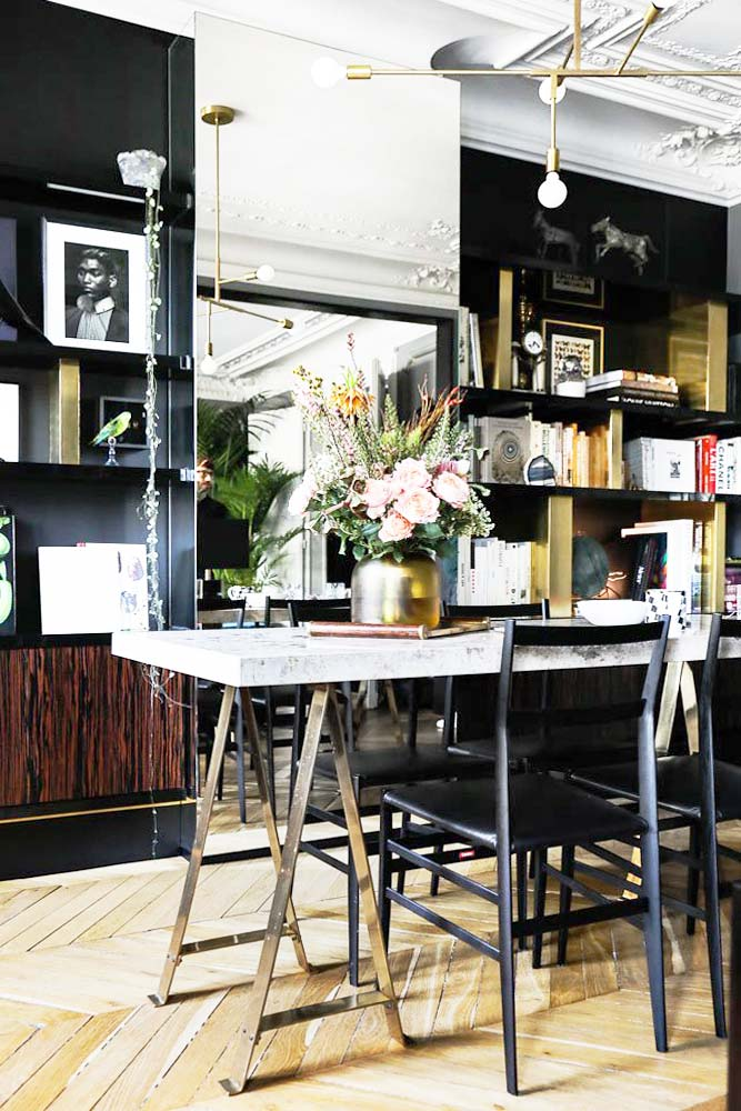 Modern marble dining table on steel trestles with open shelving on Thou Swell @thouswellblog