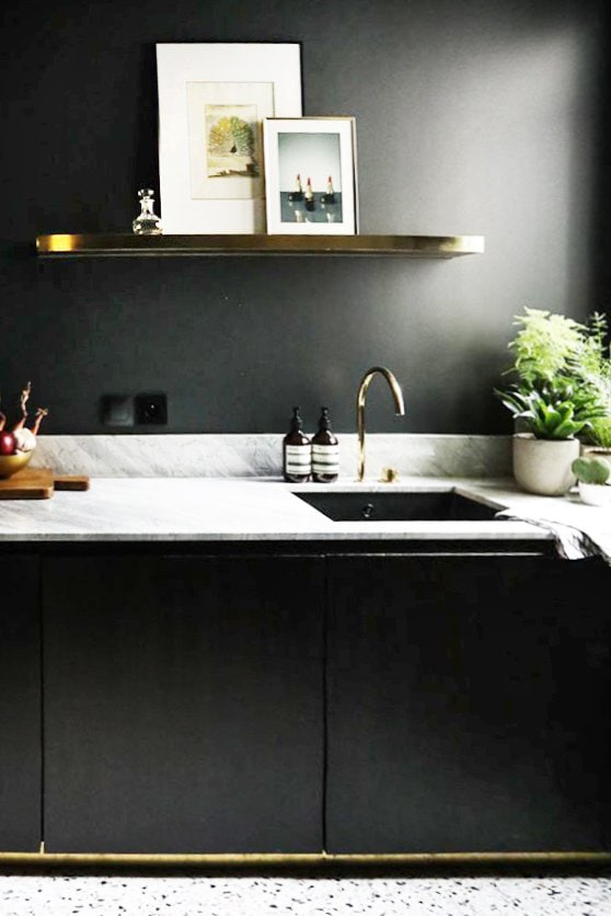 Minimal black kitchen with brass shelf and marble counter on Thou Swell @thouswellblog