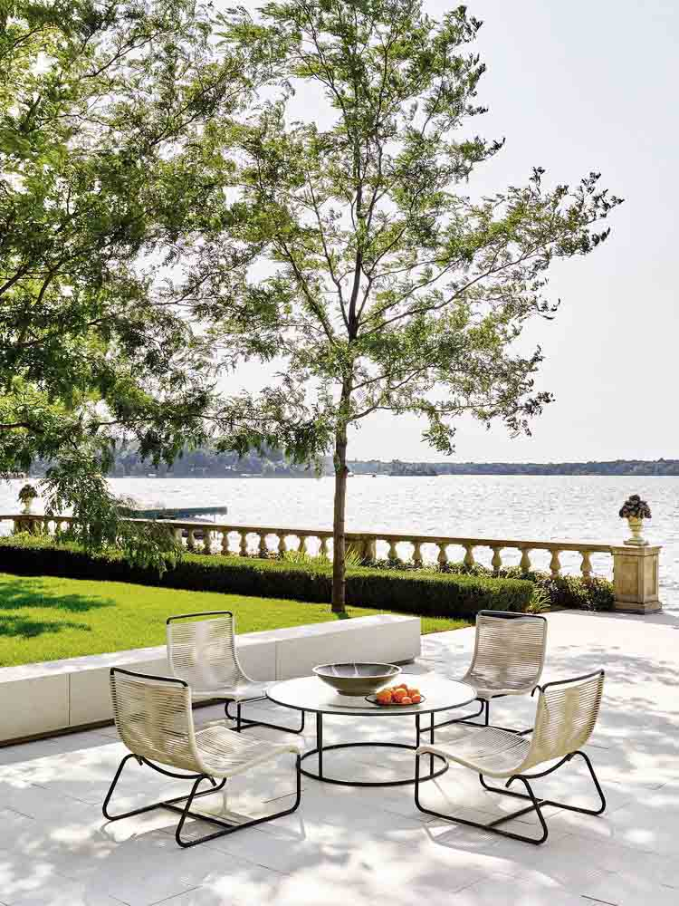 Luxury lakeside patio with modern furniture on Thou Swell @thouswellblog