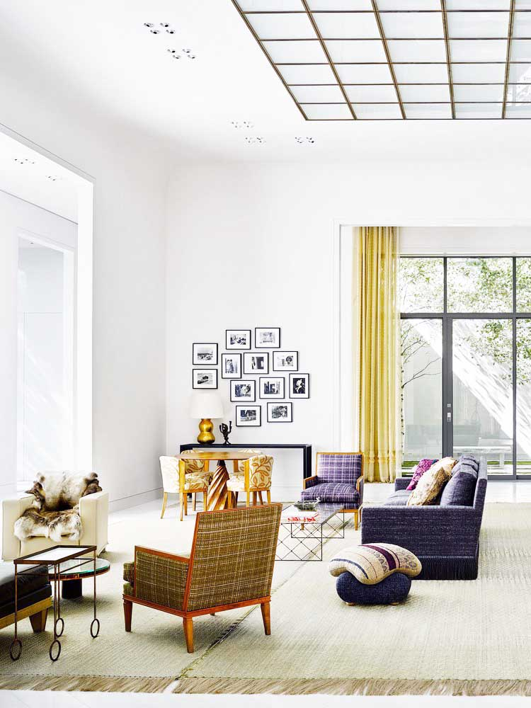 Modern lake house living room with fine art collection on Thou Swell @thouswellblog