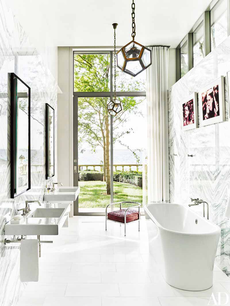 Modern lake house bathroom with free-standing bathtub and double sinks on Thou Swell @thouswellblog