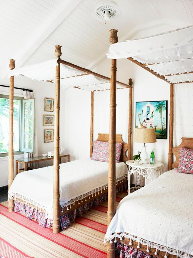 Eclectic tropical bedroom design with canopy twin beds on Thou Swell @thouswellblog