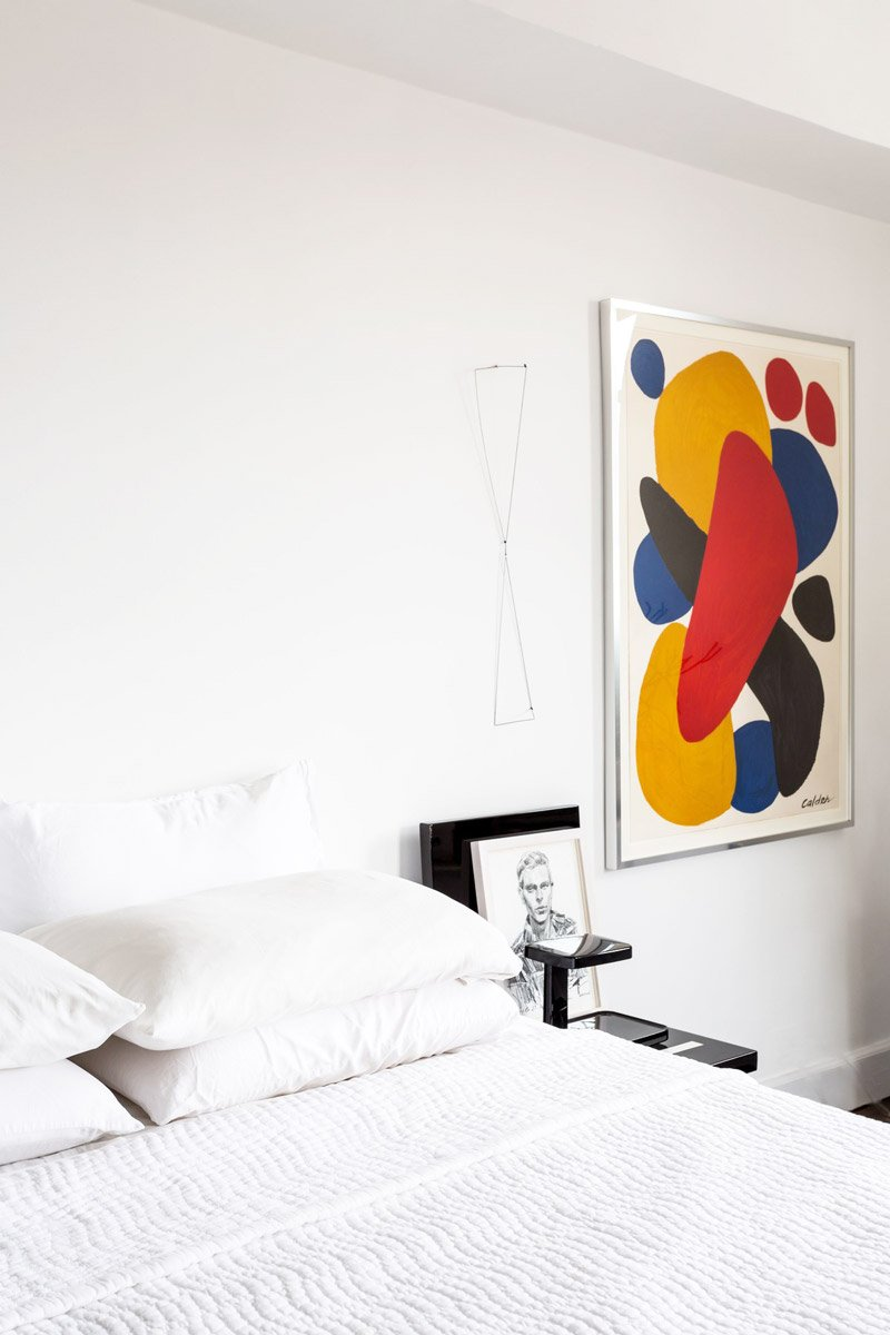 Minimal white bedroom with colorful modern art on Thou Swell @thouswellblog