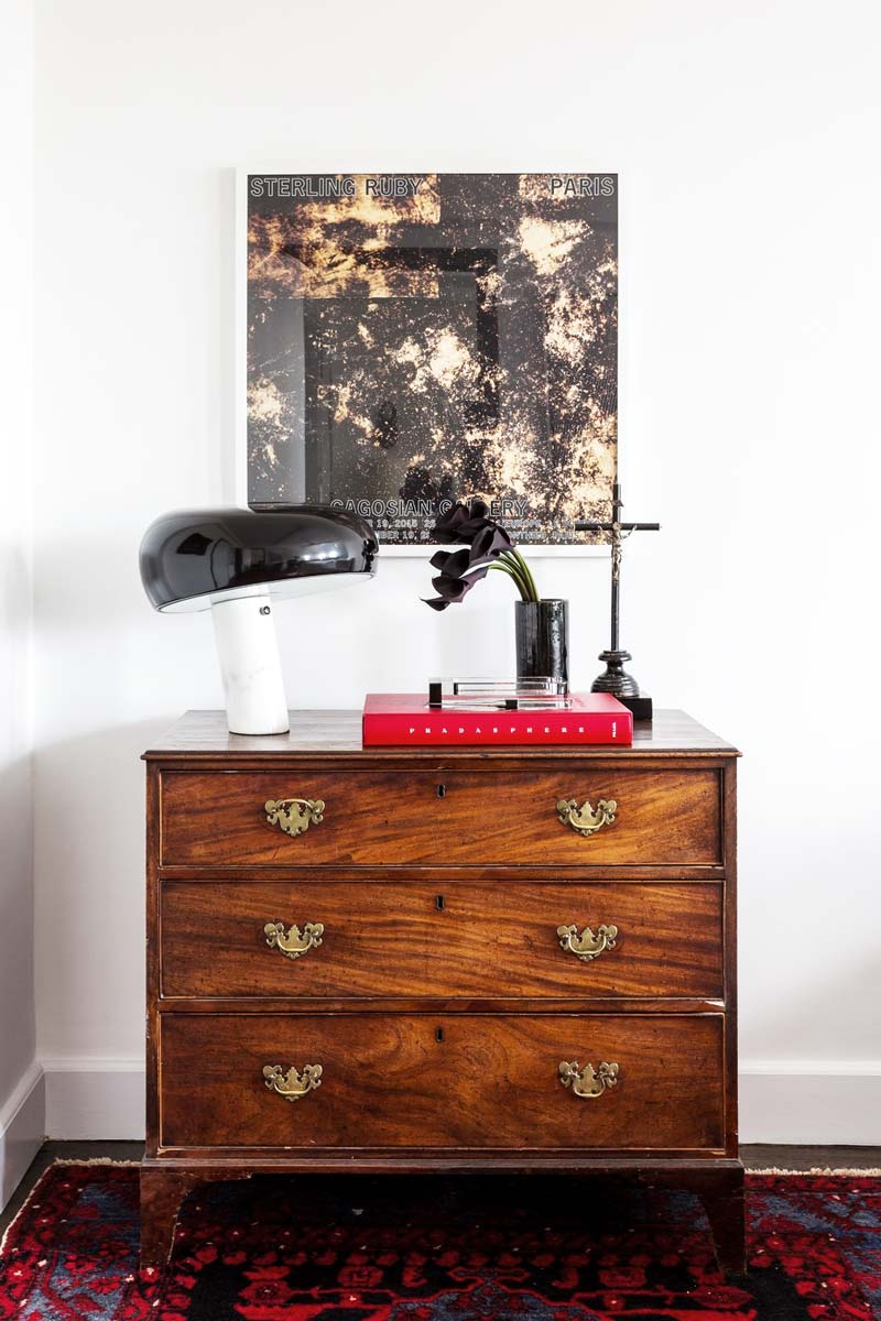 Vintage dresser with Snoopy table lamp in New York City bedroom on Thou Swell @thouswellblog