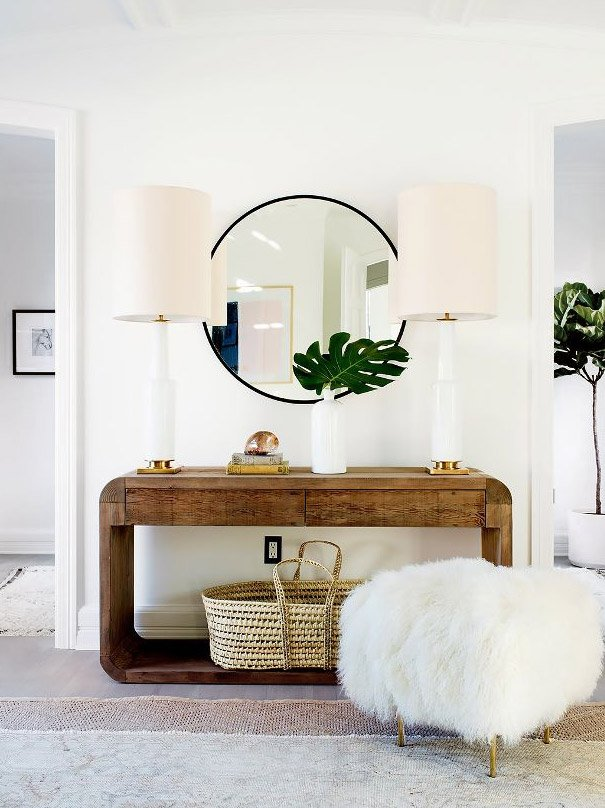 Rounded console table with large table lamps and Mongolian fur ottoman - how to choose bedroom lighting on Thou Swell @thouswellblog