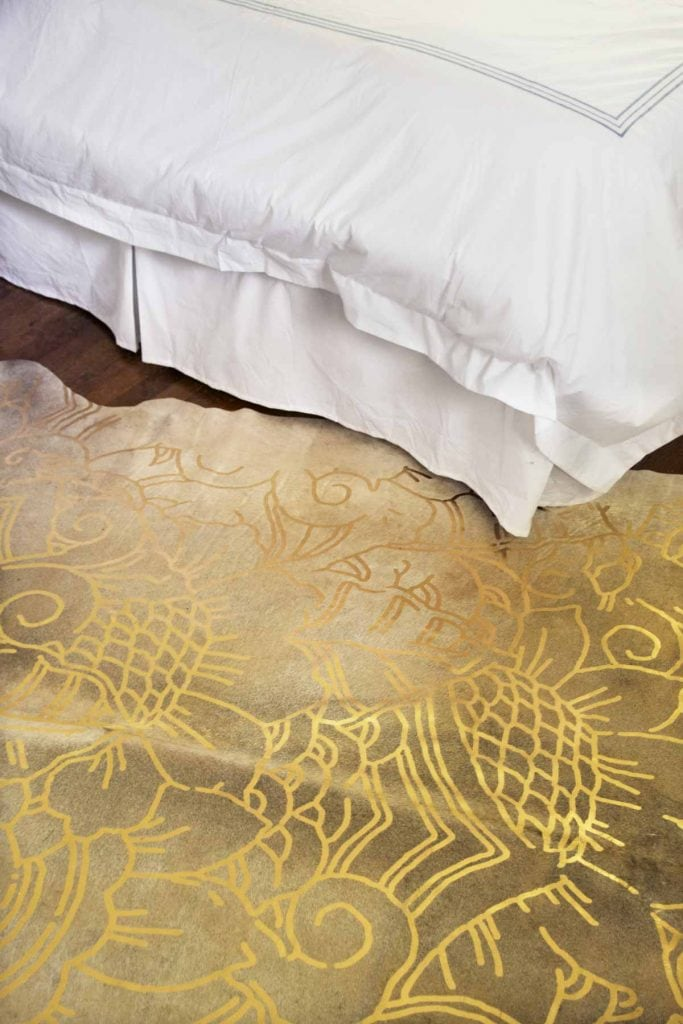 Gold patterned hide rug from ArtHide on Thou Swell @thouswellblog