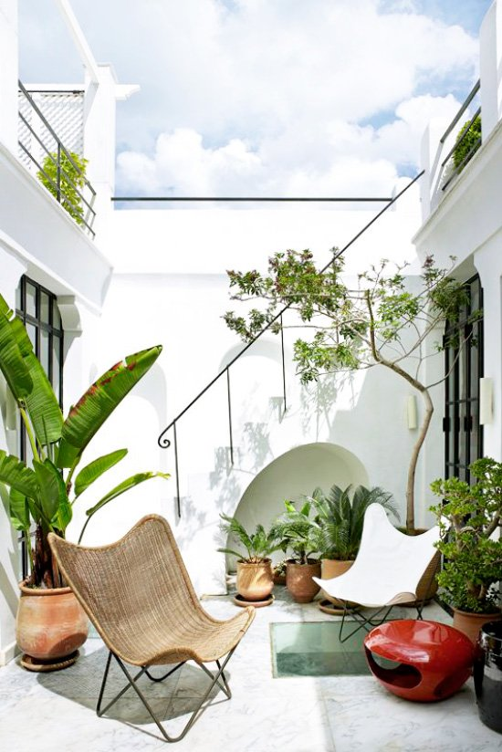 Modern patio furniture on Moroccan courtyard terrace with potted plants on Thou Swell @thouswellblog