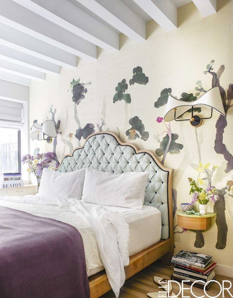 Colorful floral bedroom decor with custom wallpaper, tufted blue headboard, and spring home decor on Thou Swell #bedroom #bedroomdesign #mural #wallmural #floralbedroom #floraldesign #floralmural #wallpaper #westvillage #homedecor