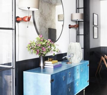 Blue console table in industrial modern hallway vignette decor with round mirror and hand sconces on Thou Swell @thouswellblog