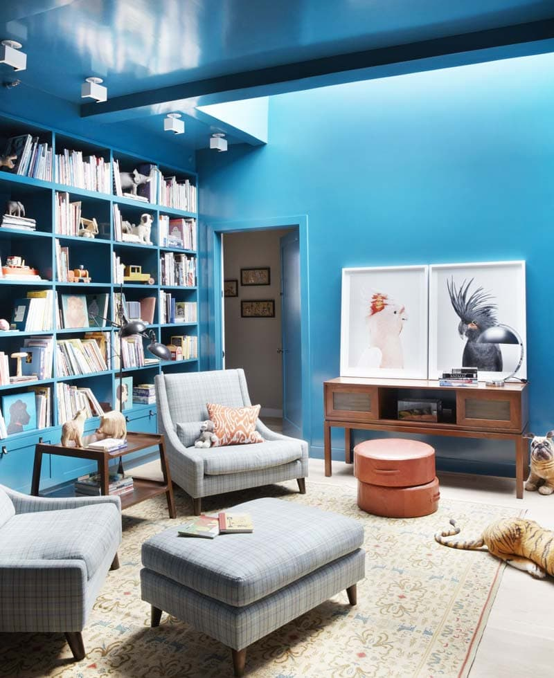 Bright blue living room with bird prints and bookshelves on Thou Swell @thouswellblog