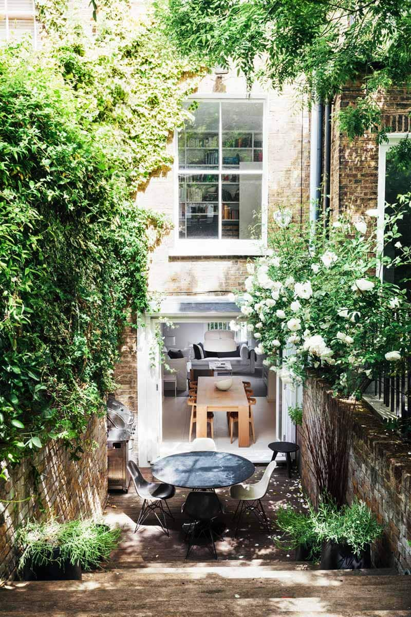 Basement doors to patio dining and garden above in London on Thou Swell @thouswellblog