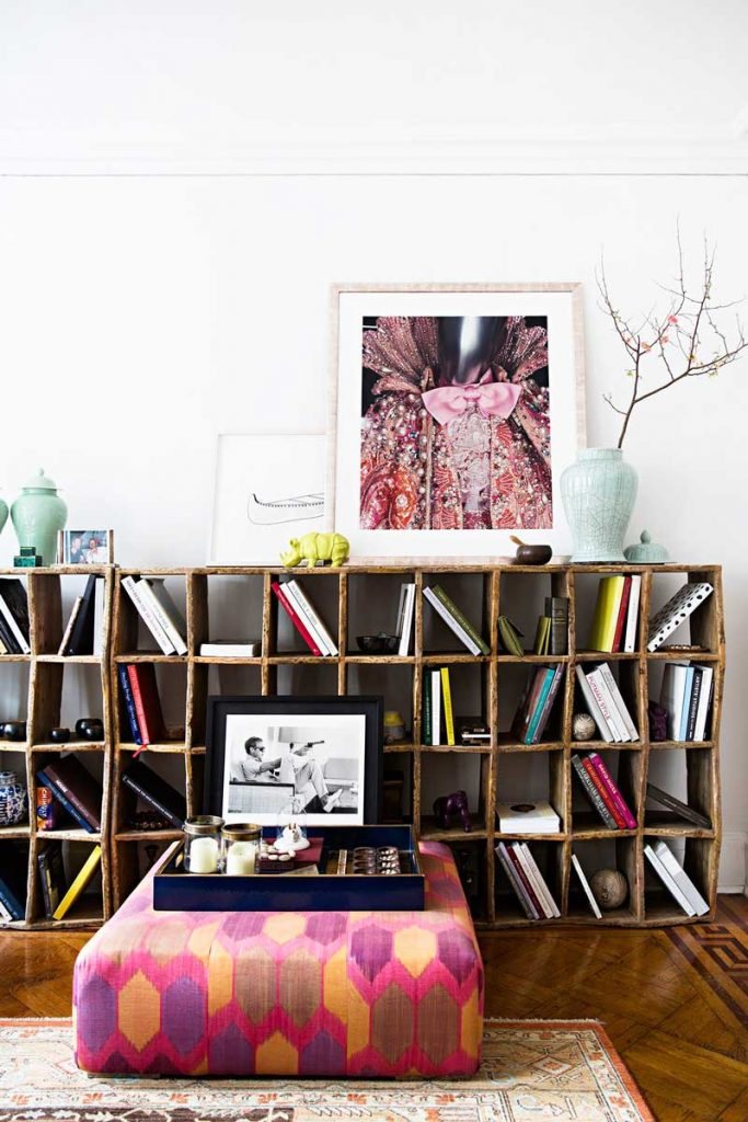 Cube bookcase with leaning artwork and custom made ottoman on Thou Swell @thouswellblog