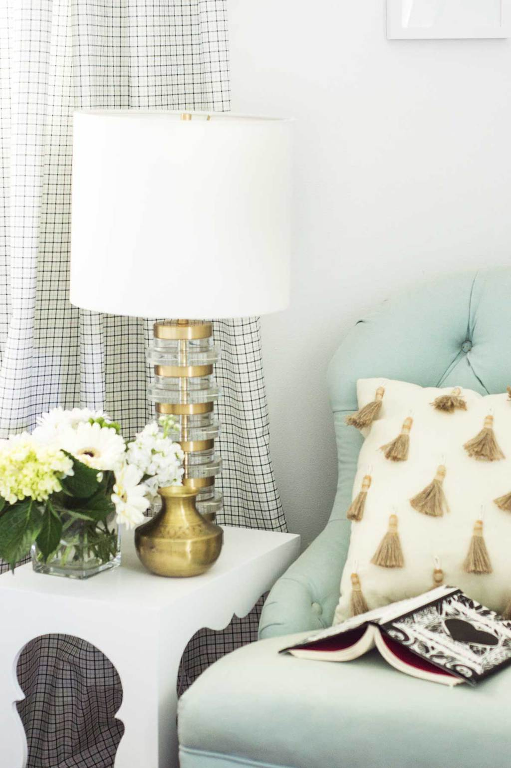 Blue tufted slipper chair with tassel throw pillow and Moroccan side table with brass table lamp on Thou Swell @thouswellblog