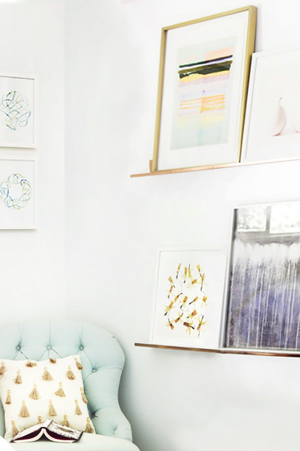 Blue tufted slipper chair with copper art shelves from Minted on Thou Swell @thouswellblog