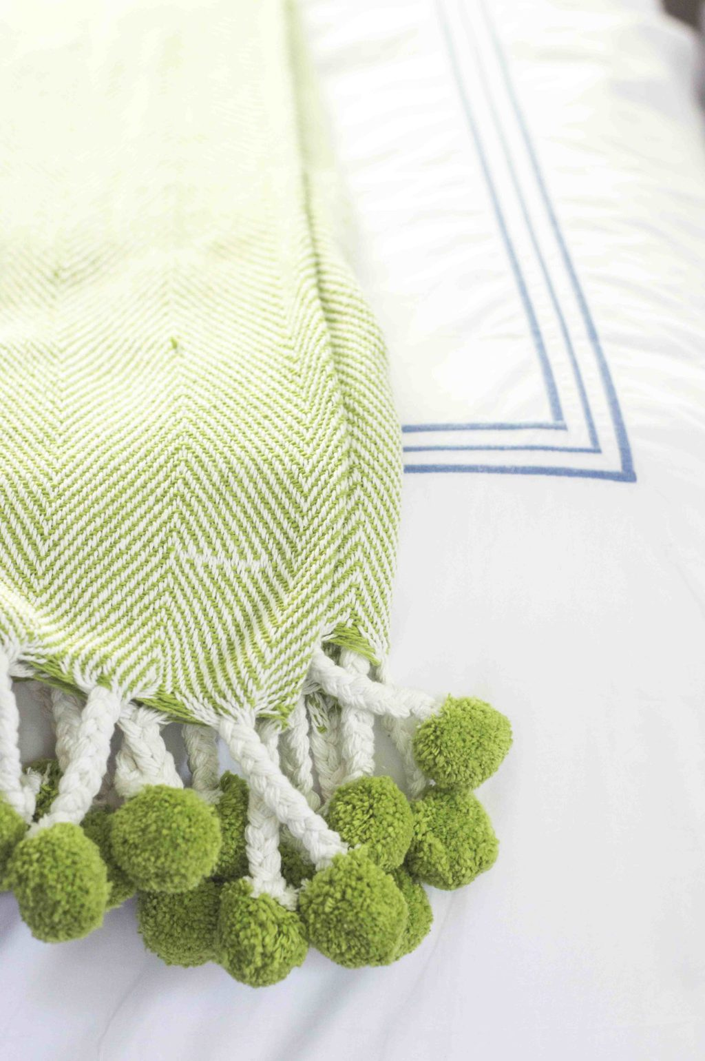 Lime green herringbone pom pom throw blanket from Waiting on Martha via Thou Swell @thouswellblog