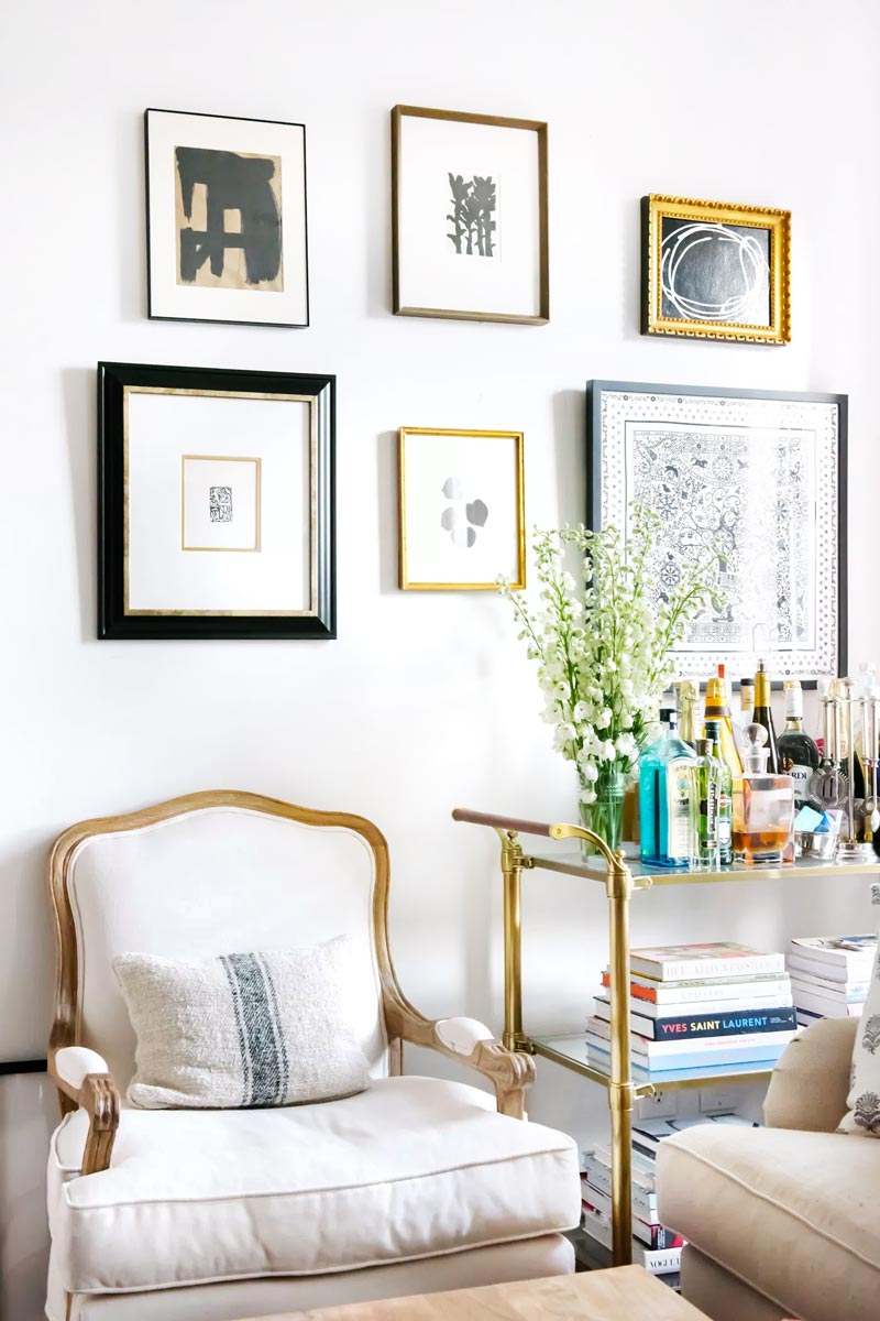 Bar cart and armchair with gallery wall in NYC apartment on Thou Swell @thouswellblog