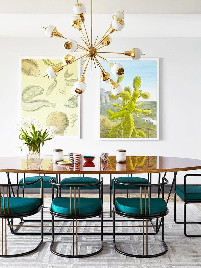 Colorful modern dining room with teal chairs and brass sunburst chandelier on Thou Swell @thouswellblog