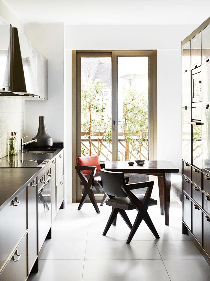 Modern galley kitchen with French doors on Thou Swell @thouswellblog