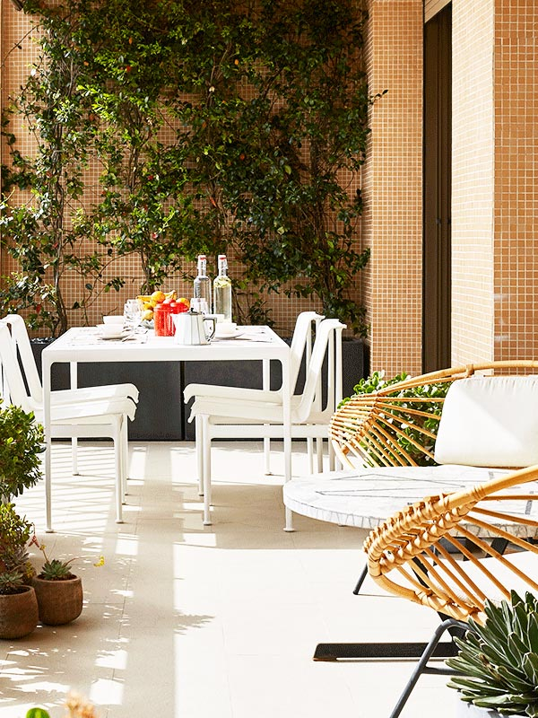 Modern French balcony patio with climbing vine and white dining set on Thou Swell @thouswellblog