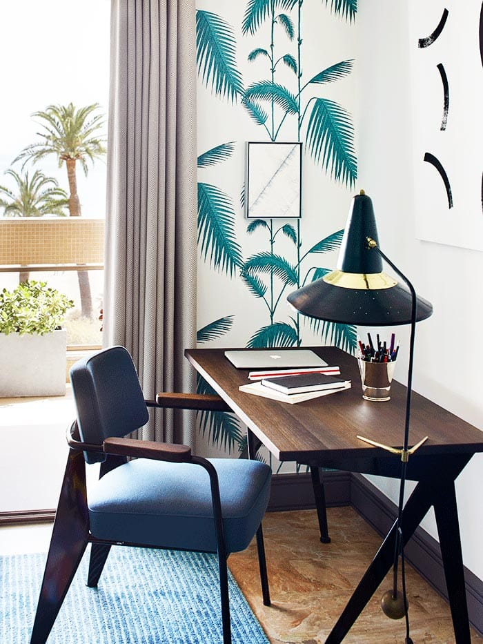 Modern desk with mid-century floor lamp and palm wallpaper on Thou Swell @thouswellblog