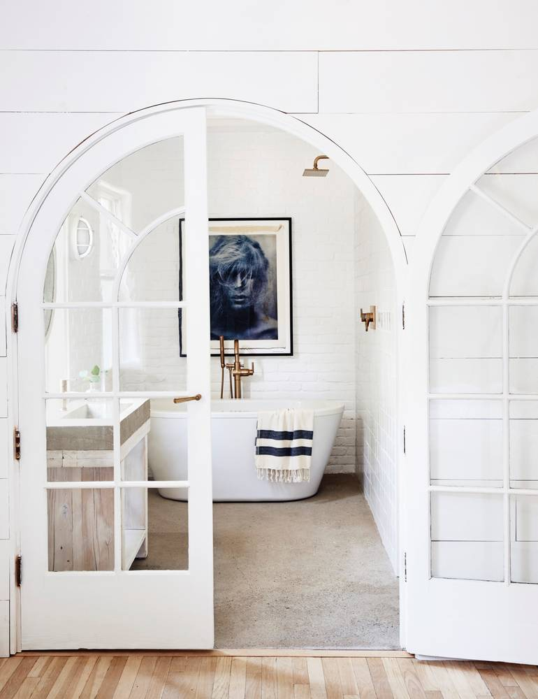 Arched double doors to bathroom on Thou Swell @thouswellblog