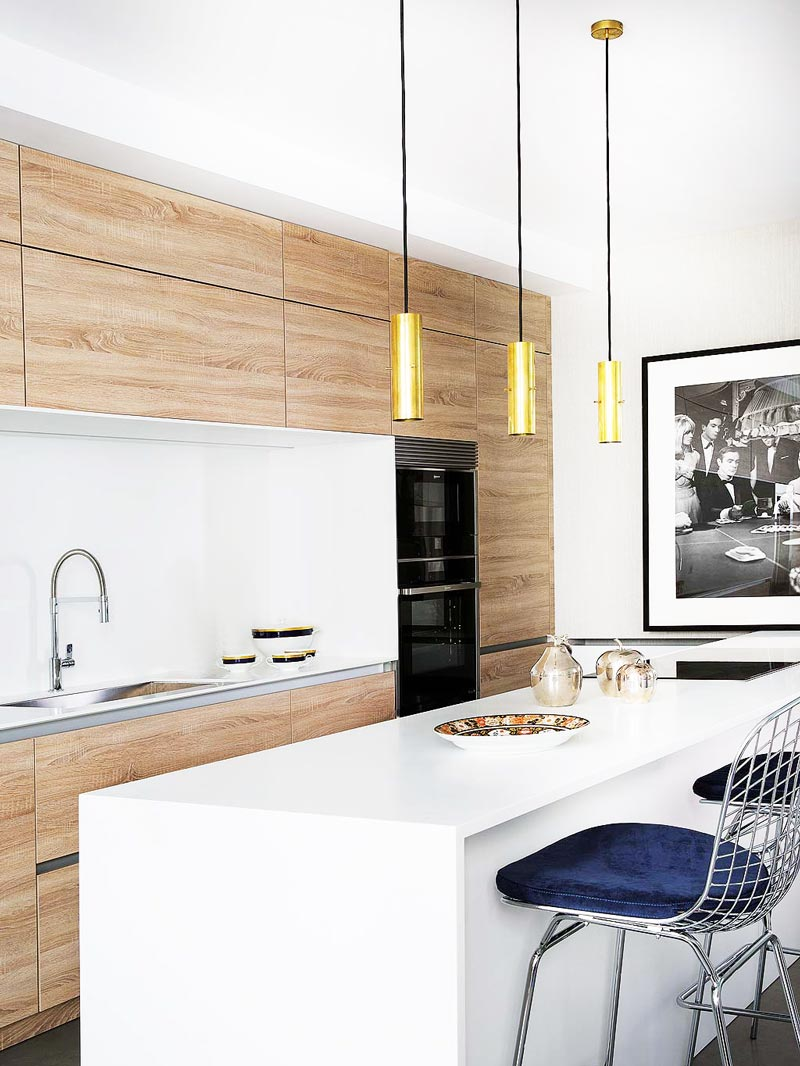 Modern kitchen with white counters and wooden cabinetry in Madrid on Thou Swell @thouswellblog