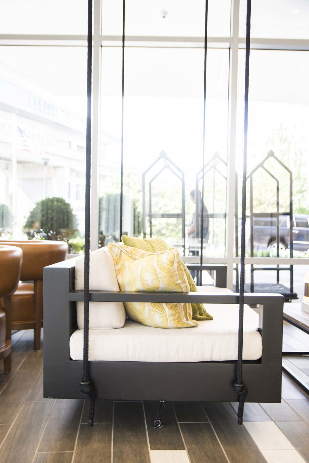 Hanging swing daybed in modern hotel lobby in the Renaissance airport hotel Atlanta on Thou Swell @thouswellblog