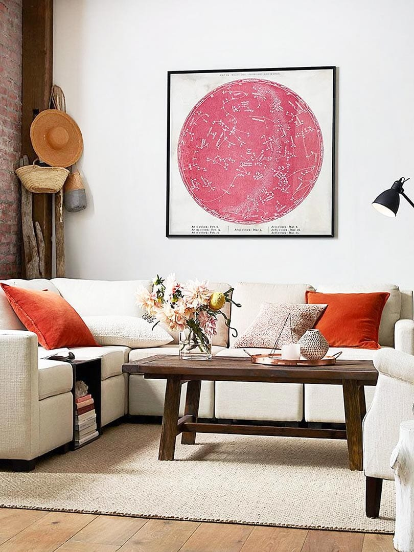 Small space living room furniture, sectional with pink astrological artwork and brick wall on Thou Swell @thouswellblog