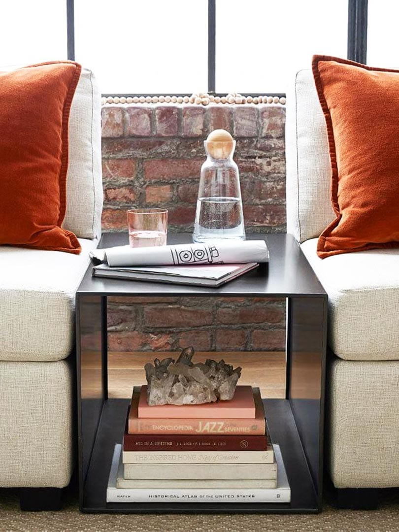 Small space furniture idea, side table between armless chairs with orange velvet pillows on Thou Swell @thouswellblog
