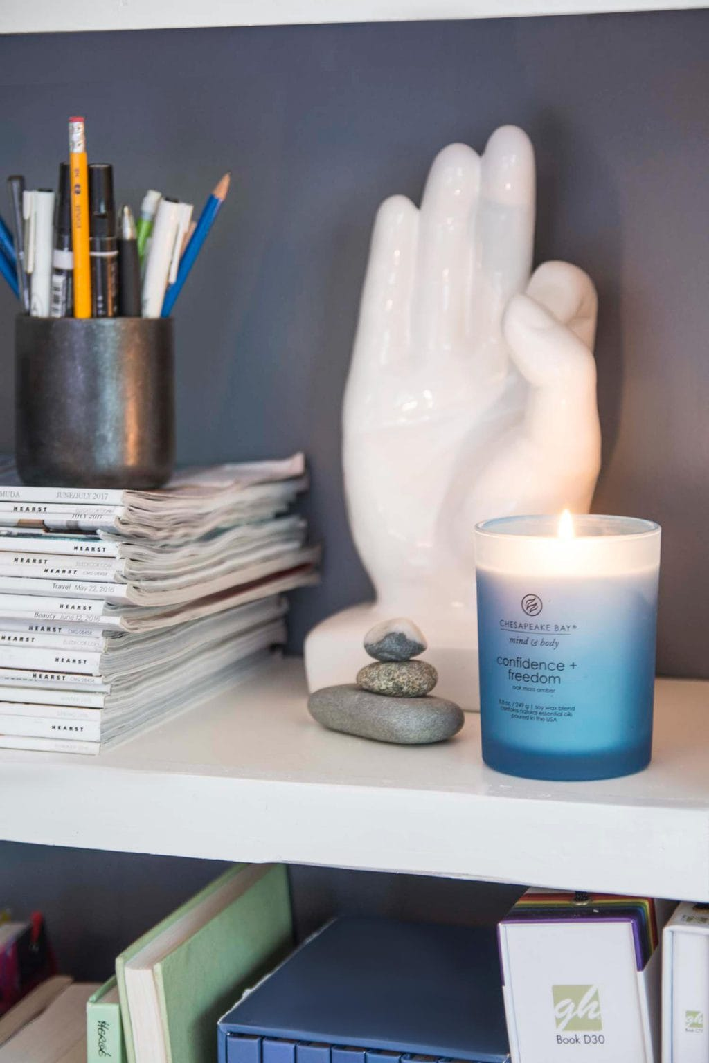Chesapeake Bay Candle in a blue bookshelf on Thou Swell @thouswellblog