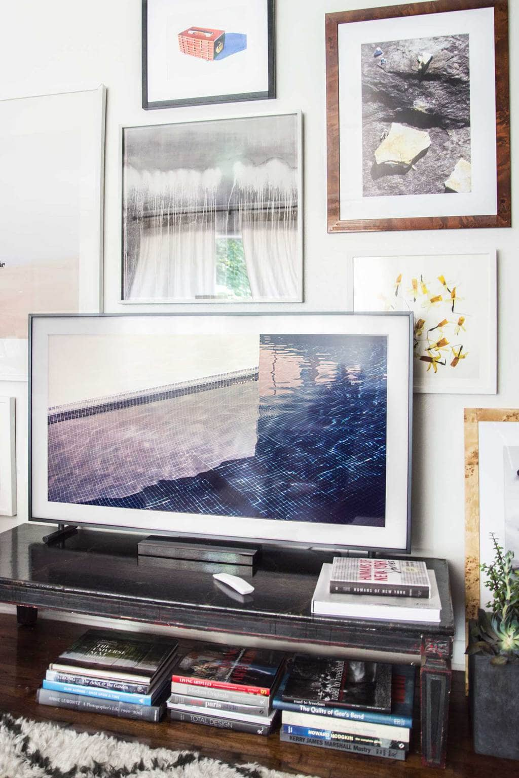 Framed TV screen with gallery wall and curated art selection for The Frame by Samsung on Thou Swell @thouswellblog