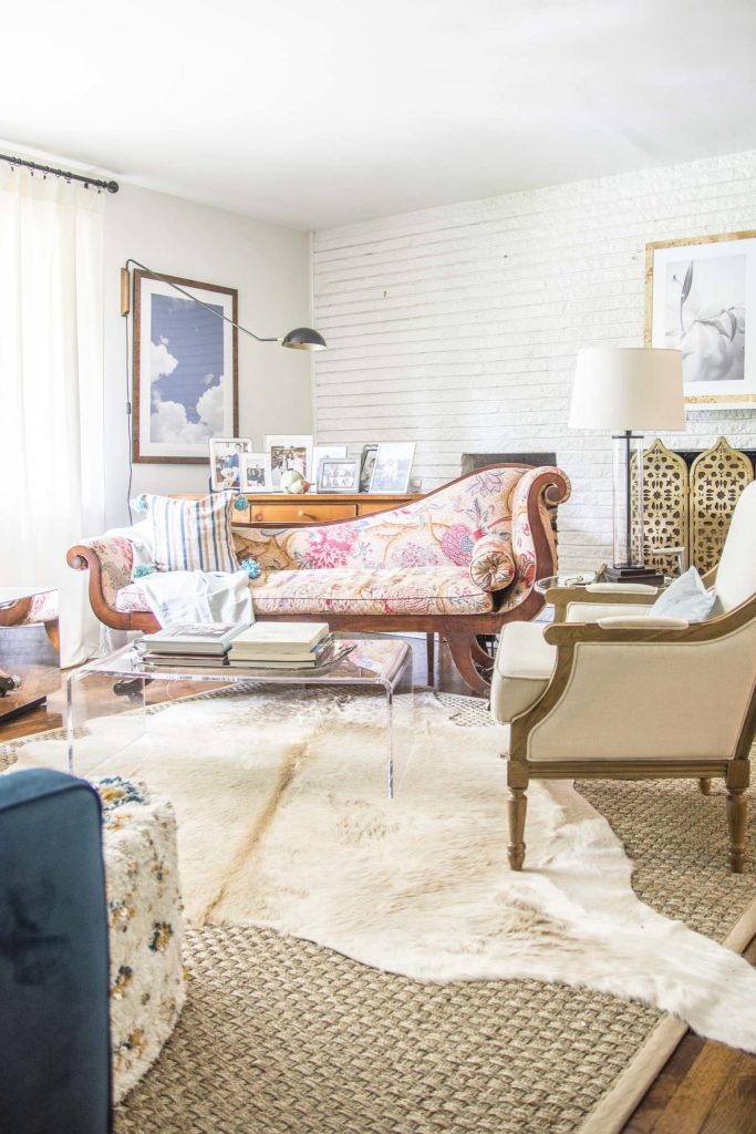 Eclectic living room with layered cowhide and seagrass rug on Thou Swell @thouswellblog