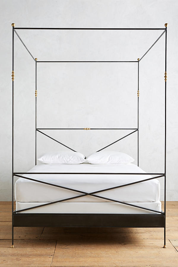 Canopy bed with metal frame and brass details on Thou Swell @thouswellblog