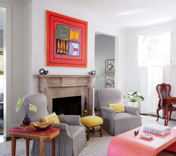 Colorful New Orleans living room with modern art and pink Karl Springer coffee table on Thou Swell @thouswellblog