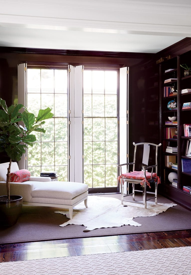 Brown lacquer library living room with chaise lounge and cowhide rug on Thou Swell @thouswellblog