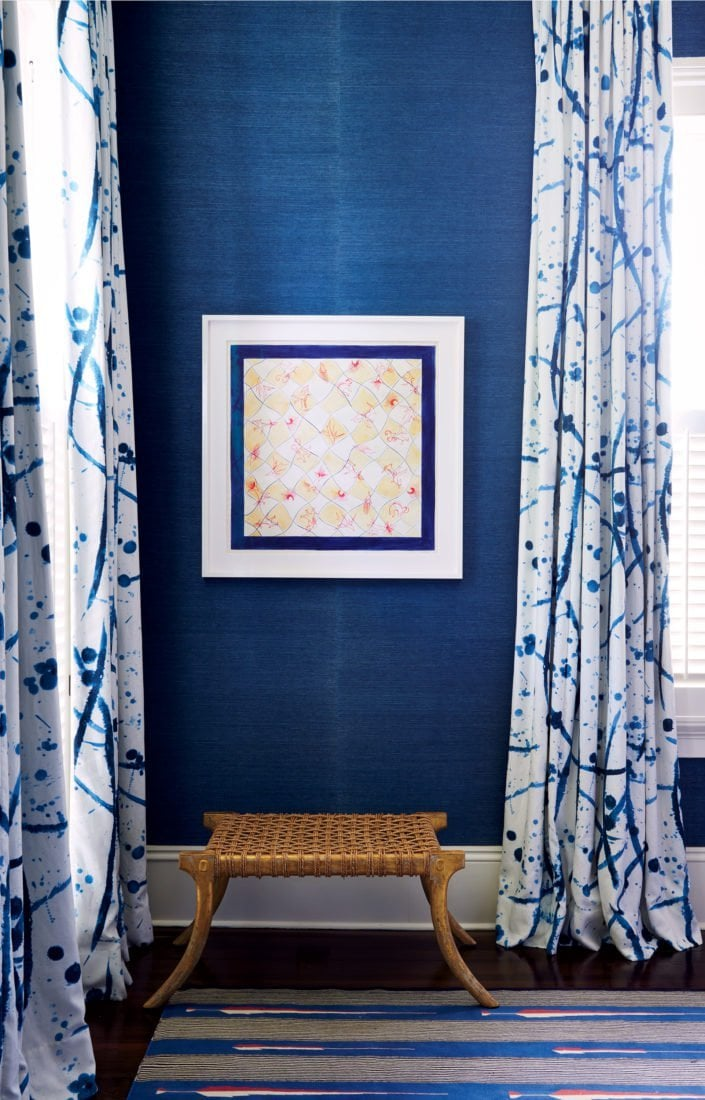Blue grasscloth wallpaper with blue and white pattern curtains on Thou Swell @thouswellblog
