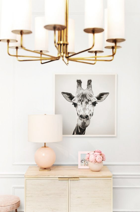 Pink decor in living room with Kate Spade wall decor and brass chandelier on Thou Swell @thouswellblog