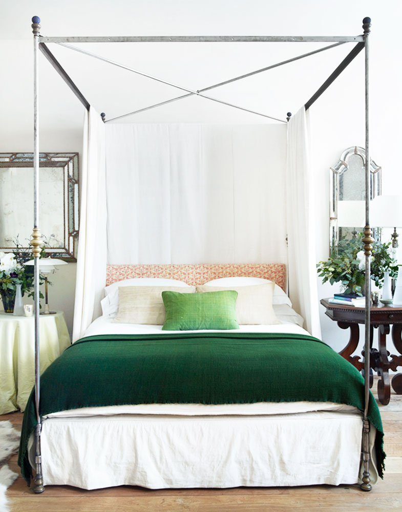 Metal canopy bed with green throw in a neo-traditional bedroom by Rose Uniacke on Thou Swell @thouswellblog