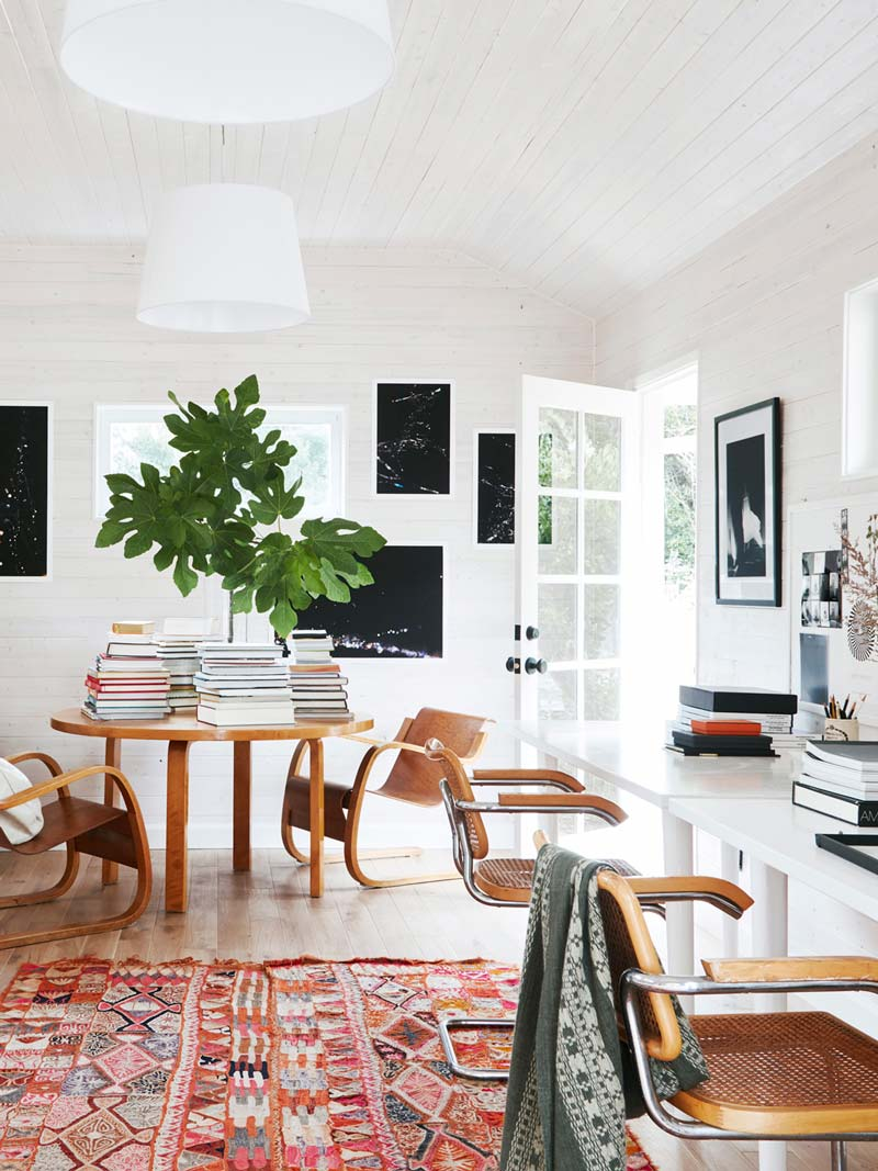 Bright and colorful home office workspace with entry table piled with books and white-washed ceiling on Thou Swell @thouswellblog