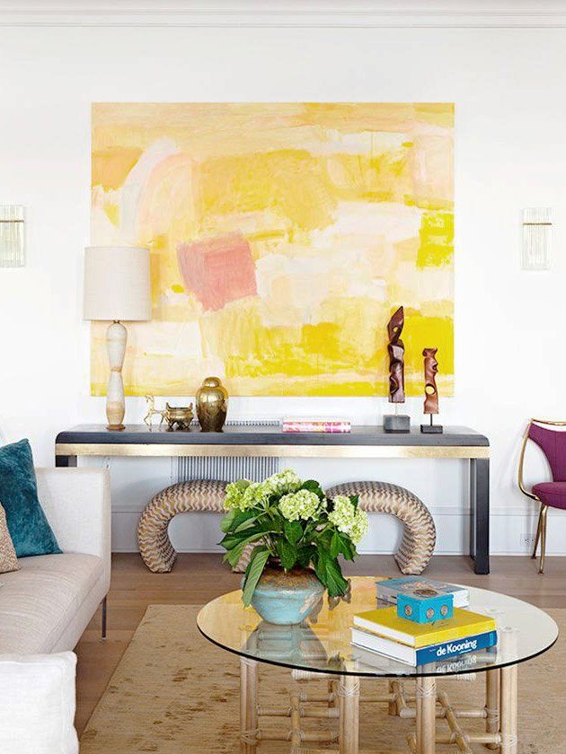Colorful living room with large yellow abstract painting and black console table in Charleston home on Thou Swell @thouswellblog