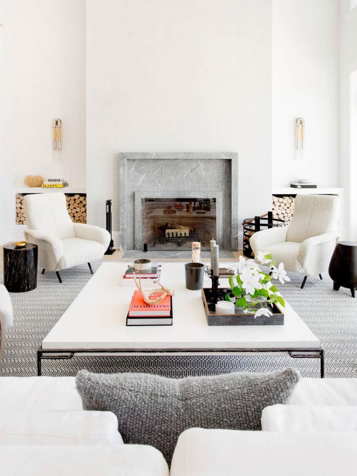 Modern white living room with tall ceilings and large square coffee table on Thou Swell @thouswellblog