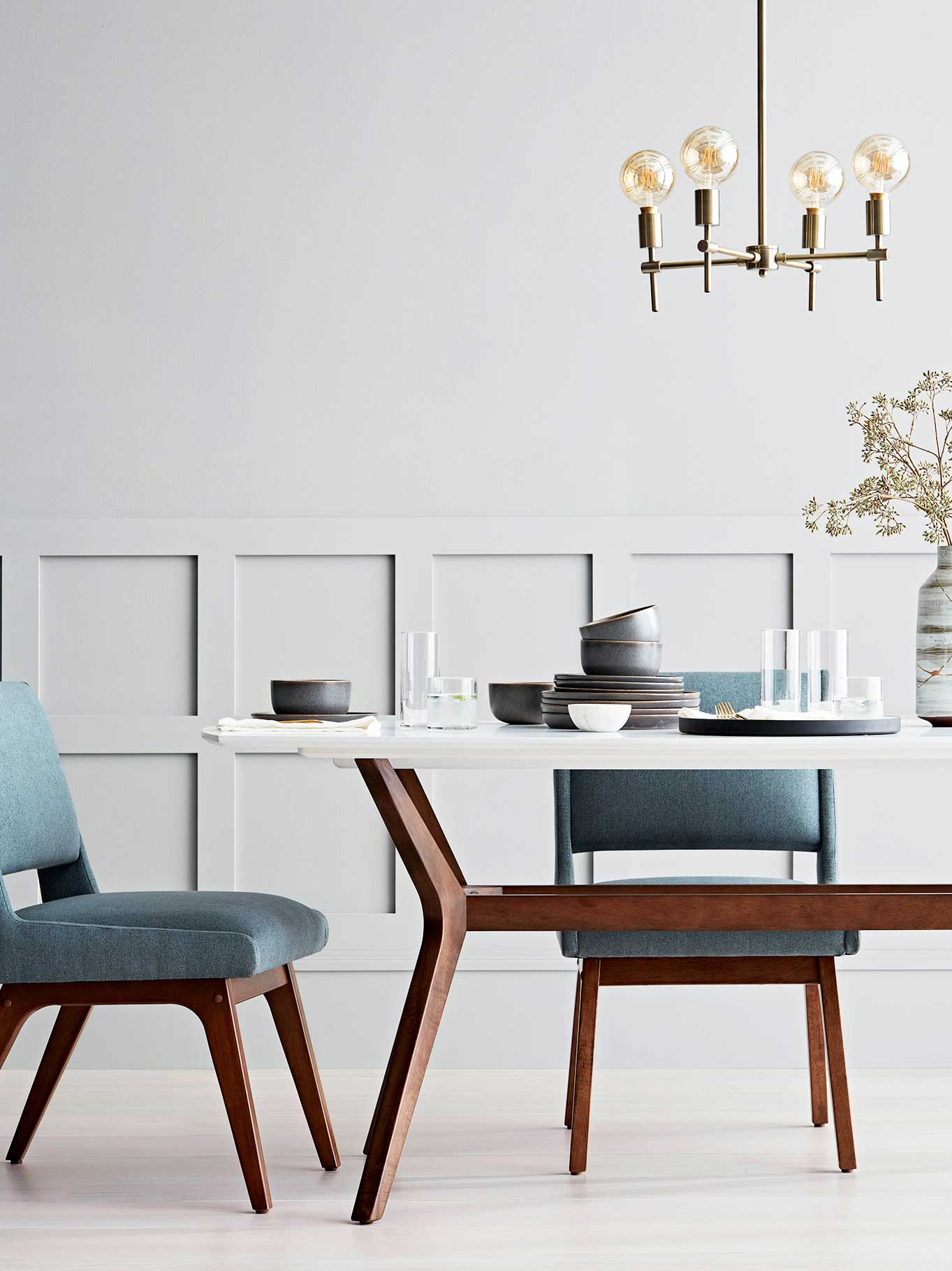 Modern dining room with blue chairs from Project 62 on Thou Swell @thouswellblog