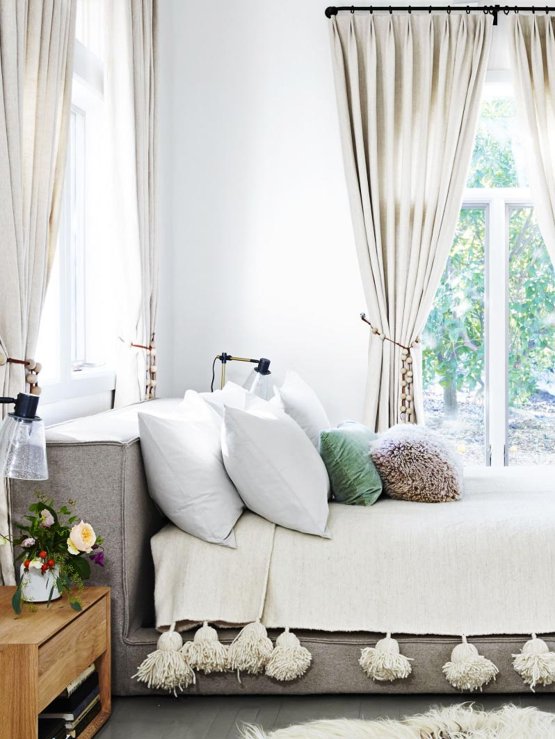 Modern California bedroom with gray platform bed and tassel coverlet on Thou Swell @thouswellblog
